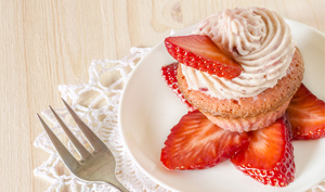 Plated Strawberry Cupcake with sliced strawberries
