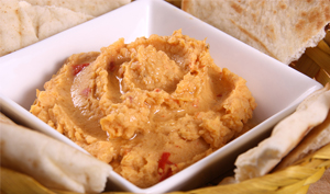 Bowl of red pepper hummus